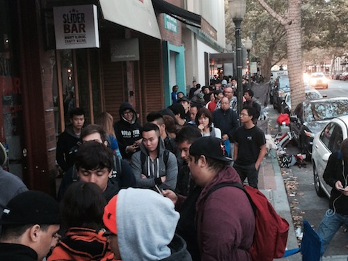 Line attendees try to catch a glimpse of the iPhone 6 prior to the Palo Alto Apple Store's opening.