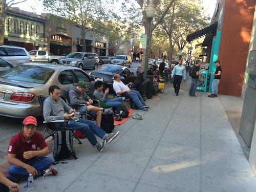 Line attendees quietly pass the time the day before the iPhone 6 launch at the Palo Alto Apple Store.
