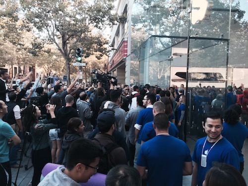 Apple Store employees get ready to open the front doors during the iPhone 6 launch.